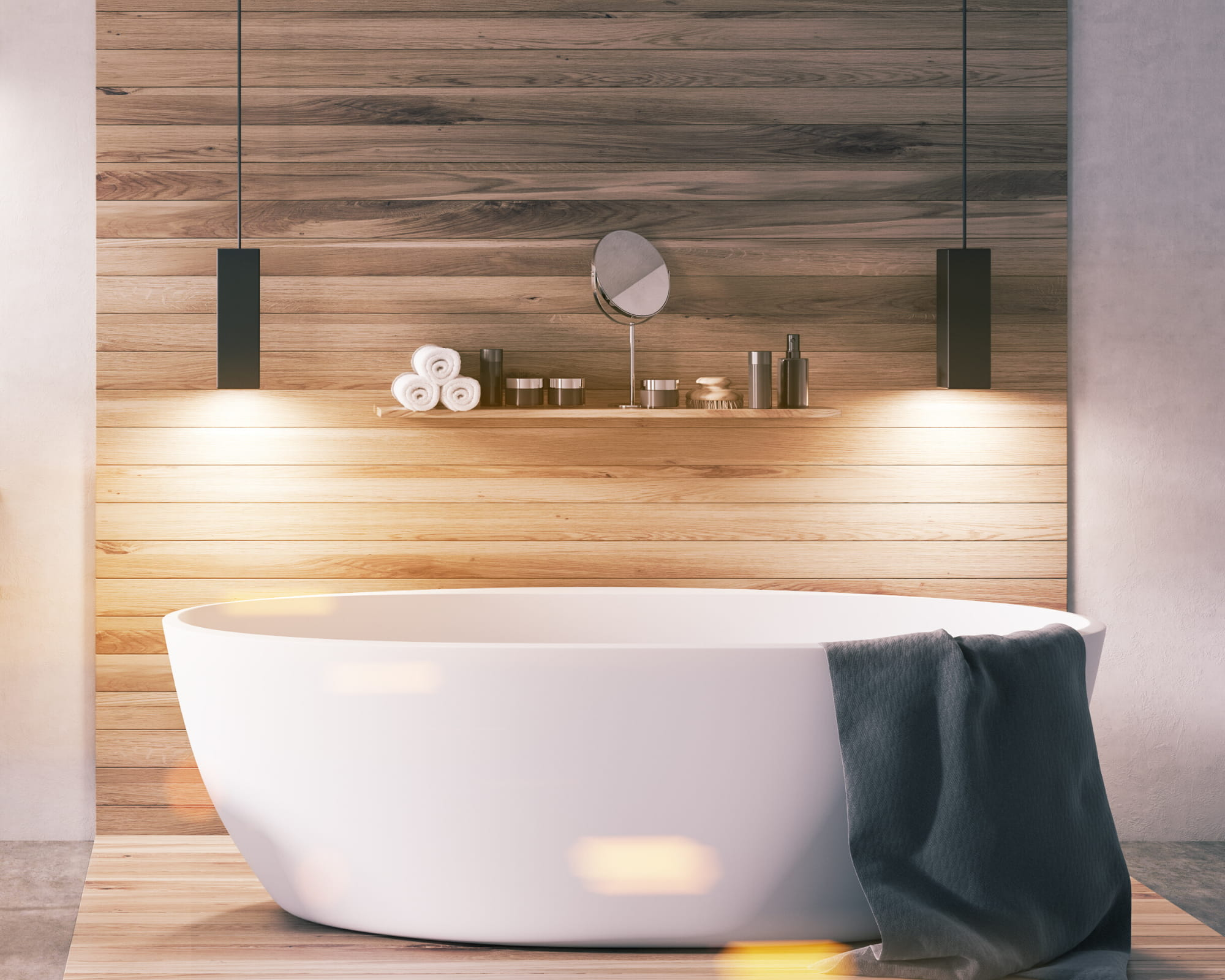 bathroom with white bath tub with bathroom lights