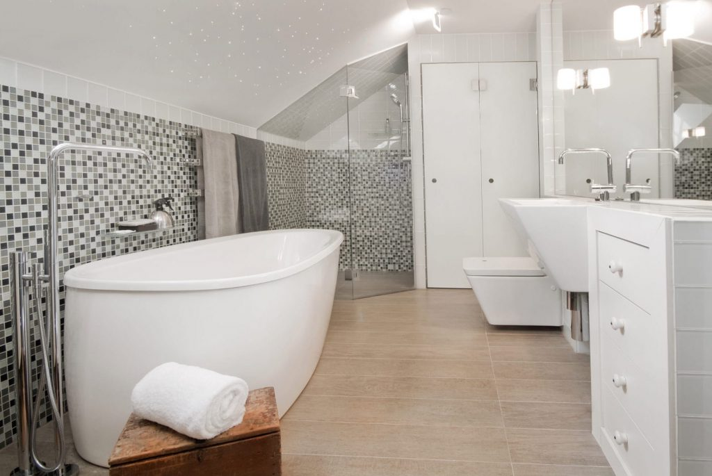 bathroom with mosaic tile on the wall