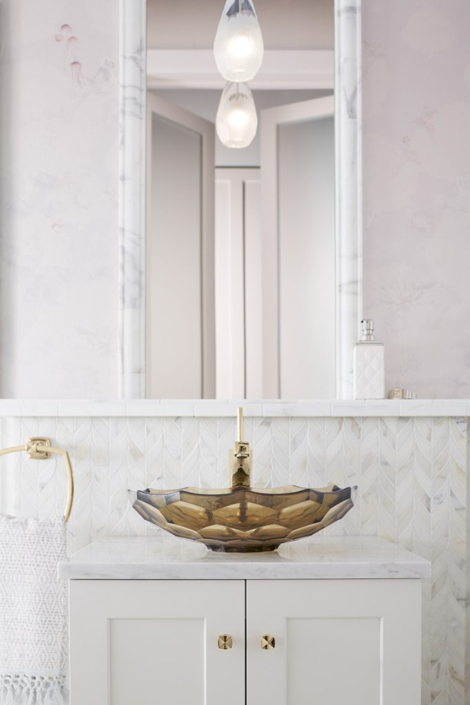 Kohler Faucet on a sink in a marble bathroom
