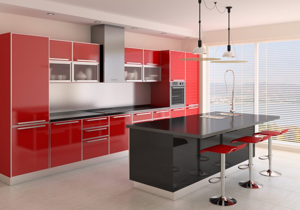 red kitchen cabinets with black countertop