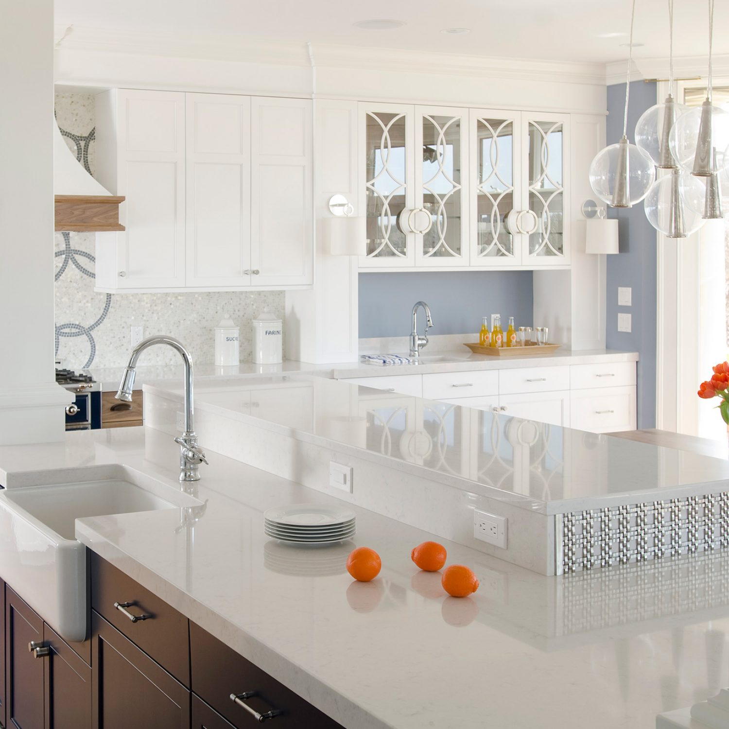 Counter tops with oranges on it in a modern kitchen