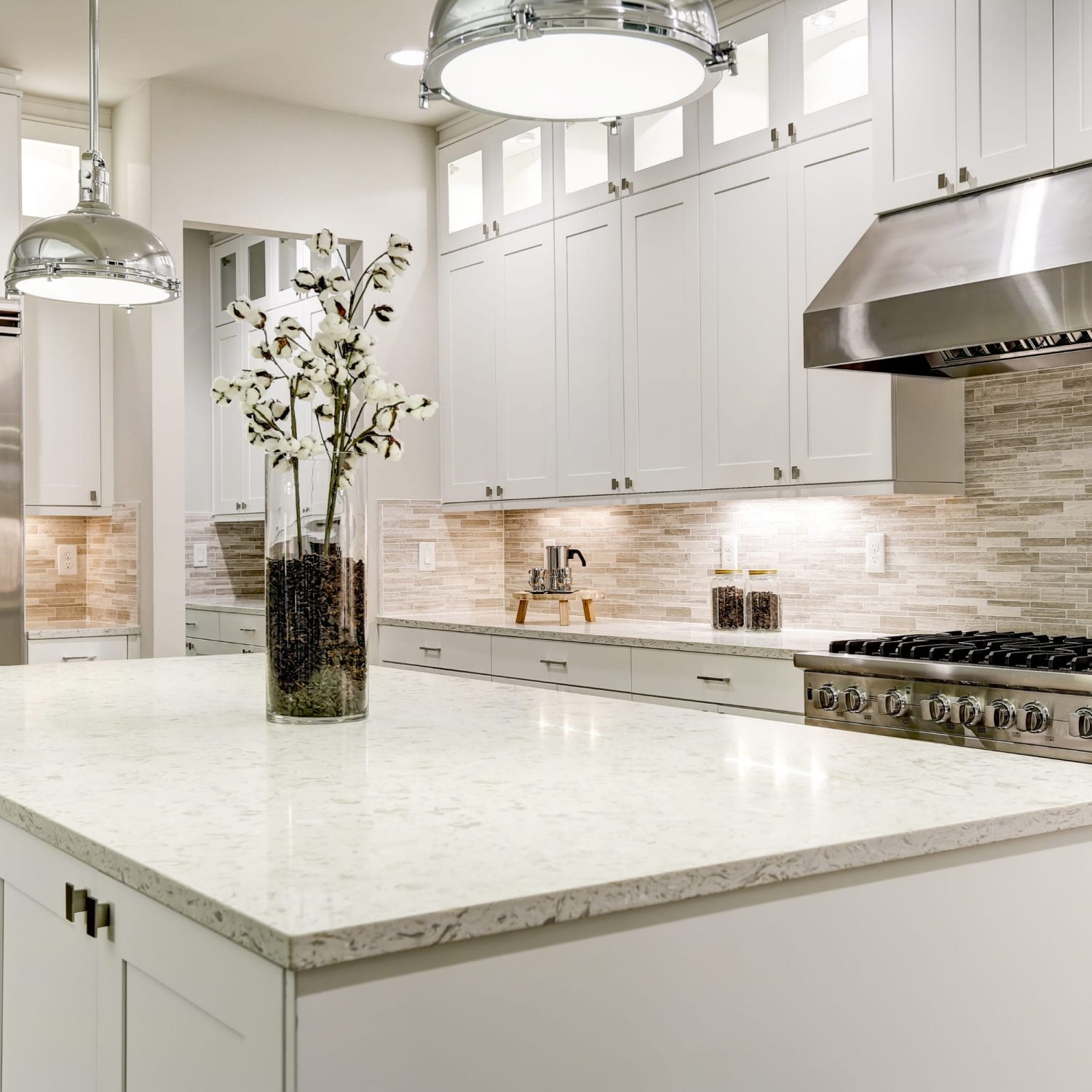 Countertops in well lit kitchen