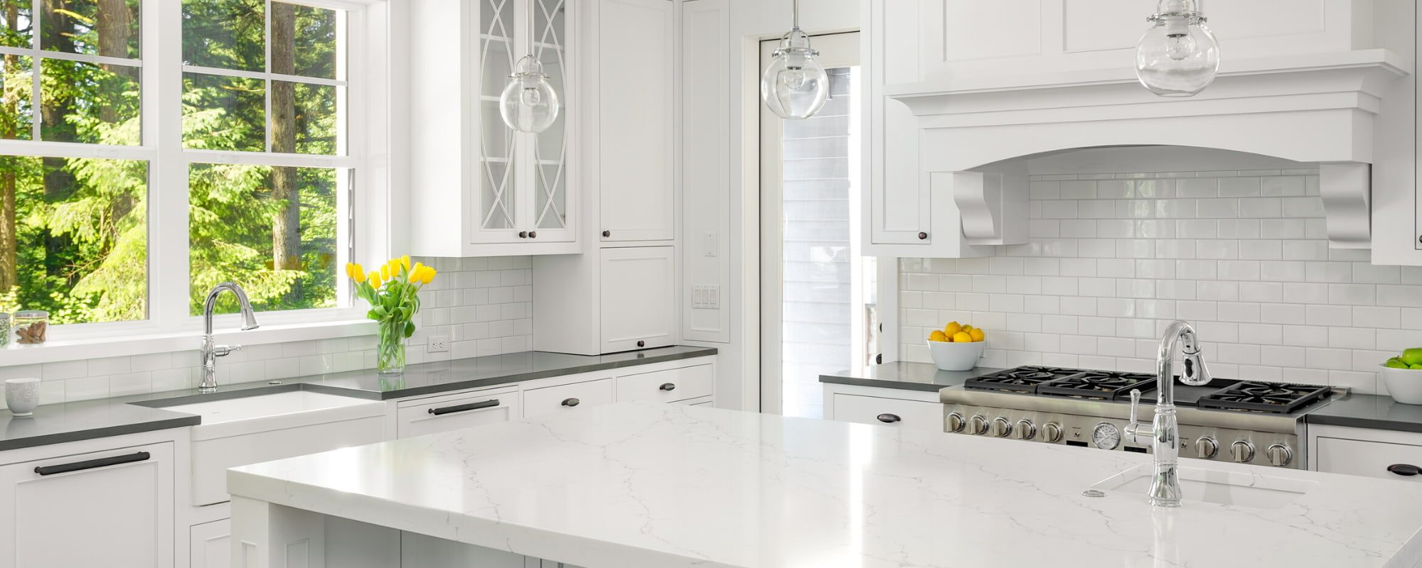 Kitchen with clean natural stone appliances